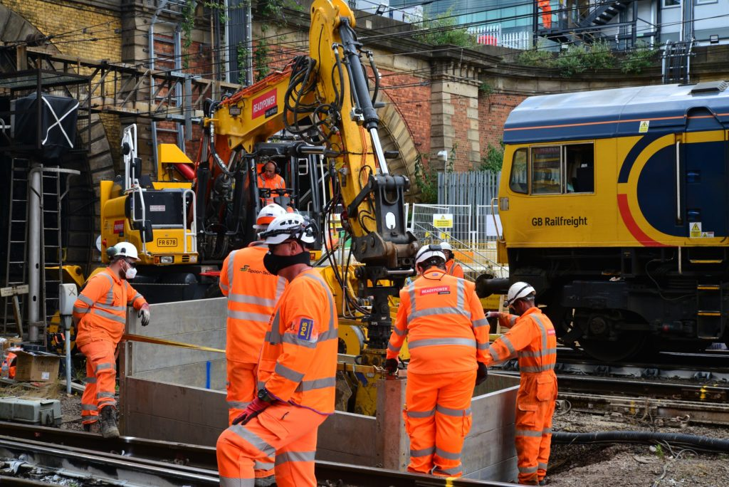 Engineers working on the tracks at London King's Cross Station