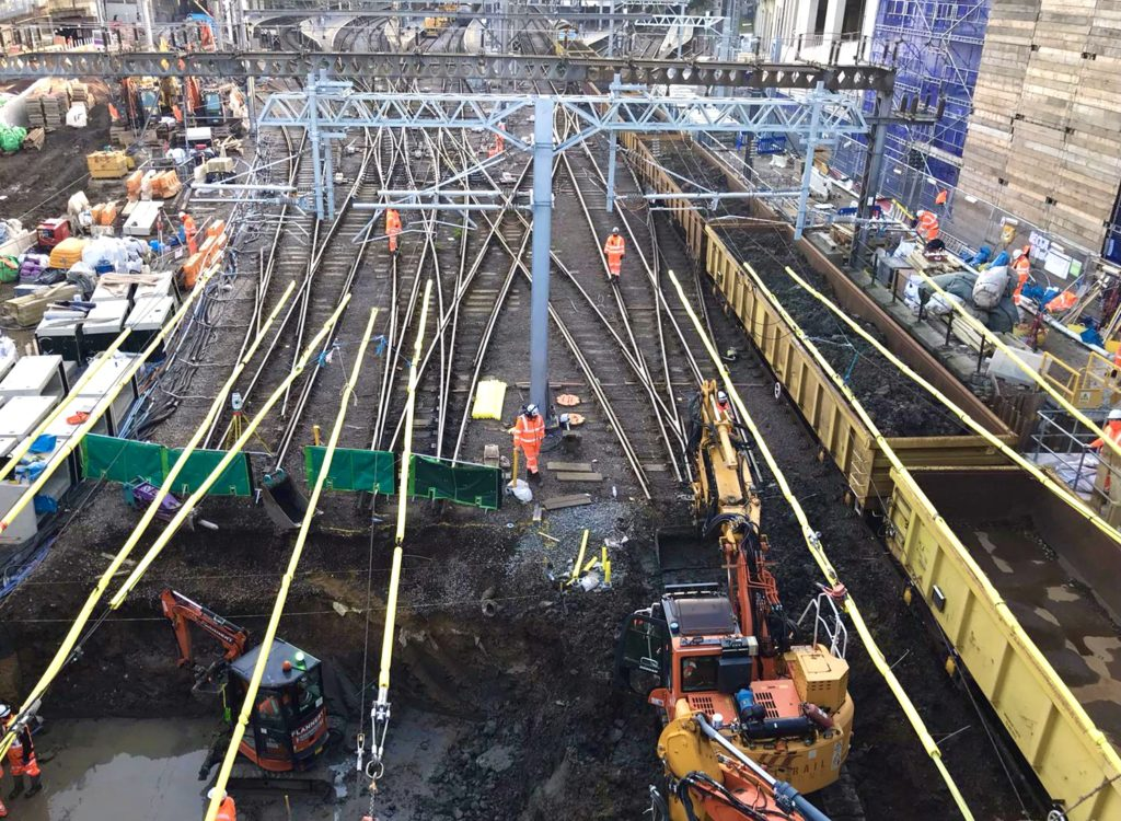 Engineers dig out the railway tracks at London King's Cross station in order to carry out major works as part of the East Coast Upgrade project.